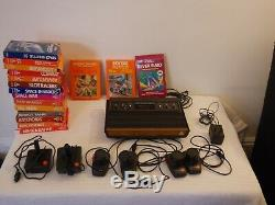 Atari 2600 CX VCS Retro Console 17Games 2 Joysticks 4 Paddles Woody Vintage Rare