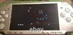 Psp 2000 Silver, with 32gb gamecard, 50 psp games, 3000 retro games