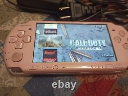 Sony PSP 3000 64 GB with 85 games + retro games with Charger and battery PINK